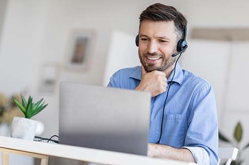 Hotline Support Service. Male call center operator in headset wo
